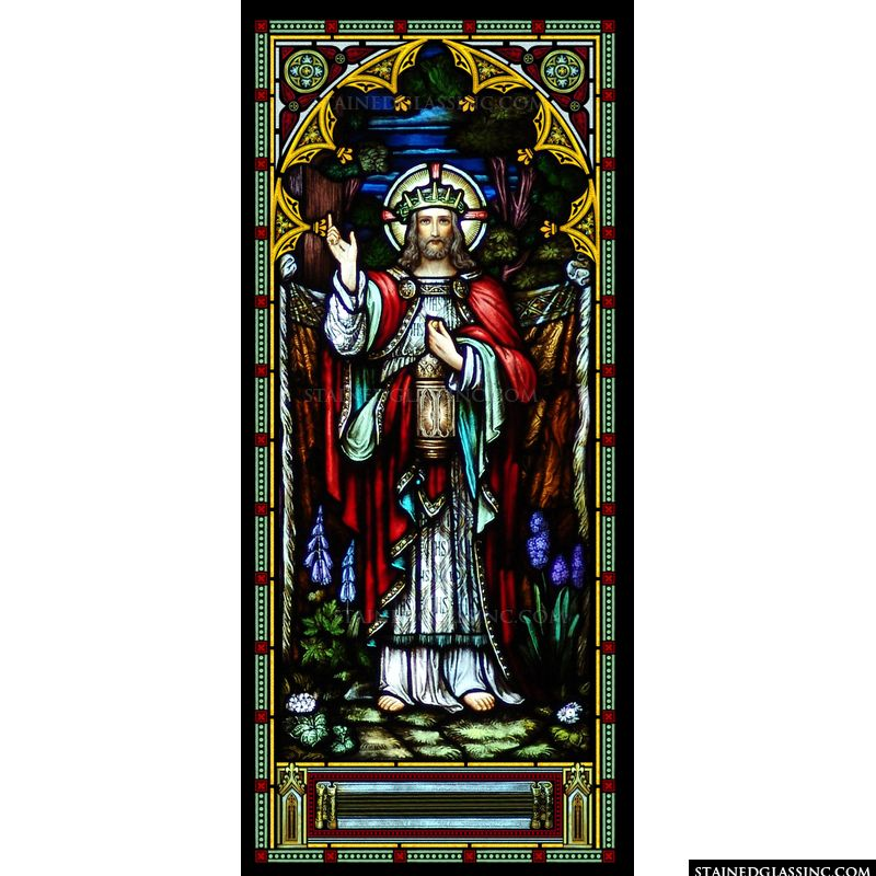 Jesus is pictured crowned and holding a lamp in this stained glass image.