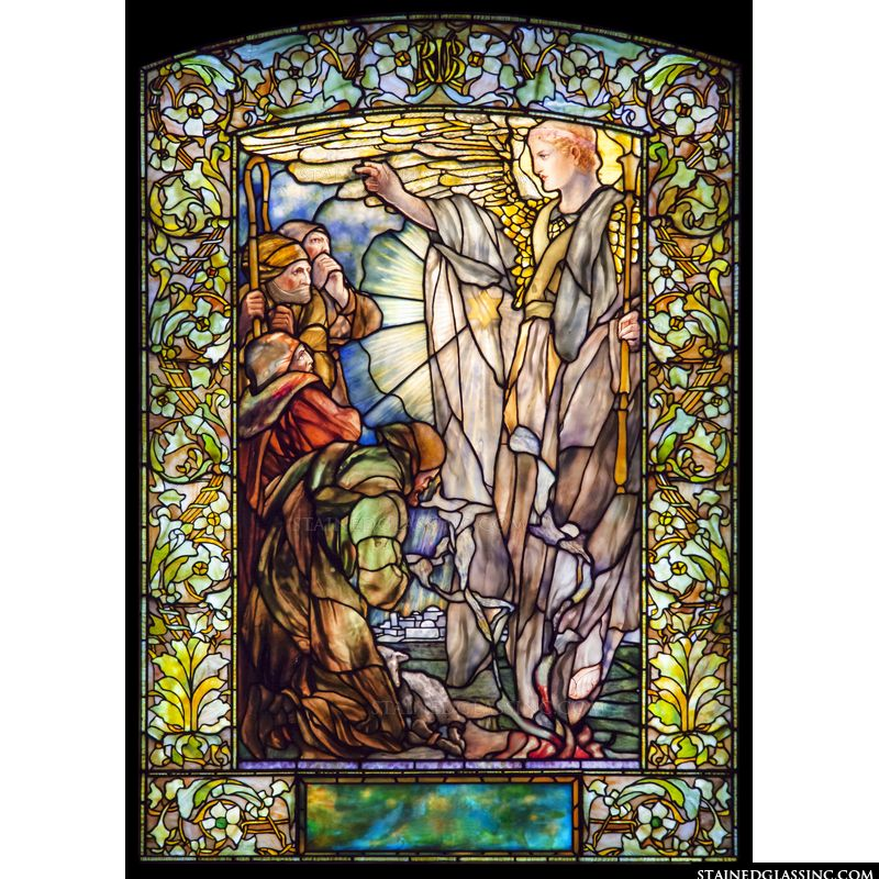 Shepherds and an angel in stained glass.