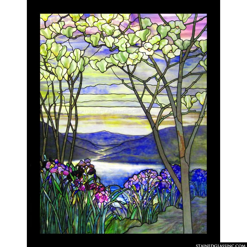 This stained glass image features a Tiffany style landscape