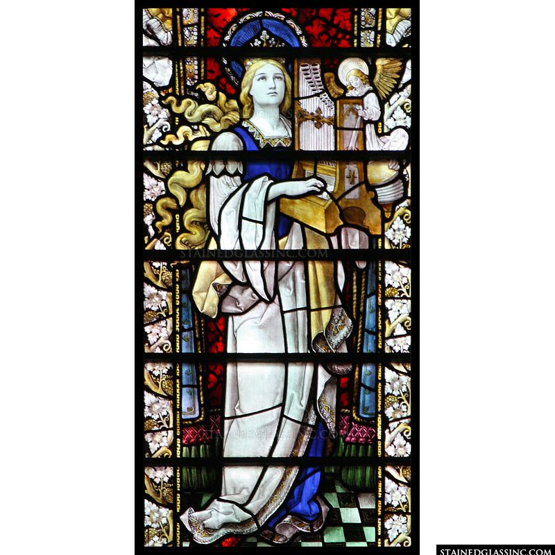 Stained glass depiction of St. Cecilia.
