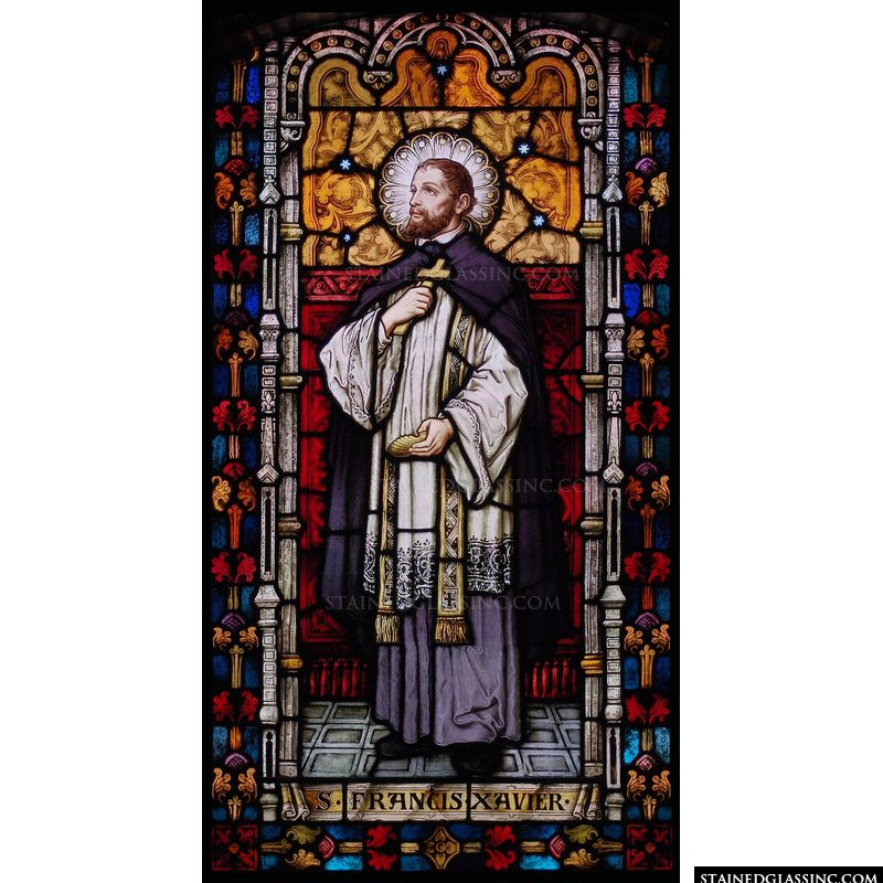 A beautiful stained glass window panel features Saint Francis Xavier.
