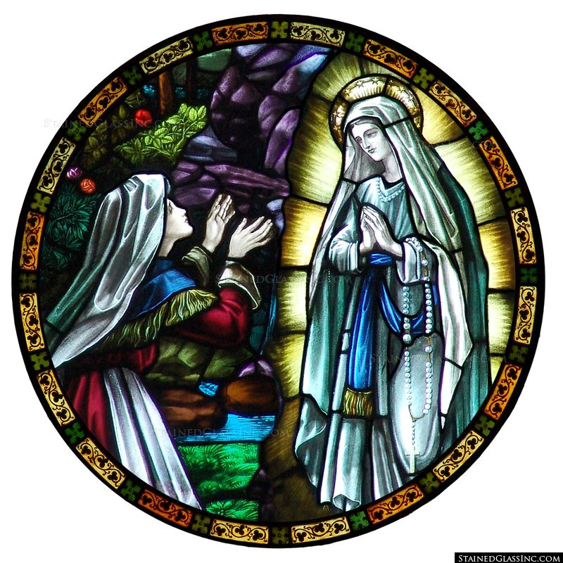 Our Lady of Lourdes is depicted in colorful stained glass.