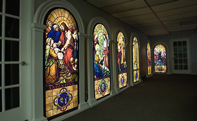 A wall is filled with LED lit stained glass panels