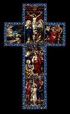 A stained glass cross representing the passion and death of Jesus.