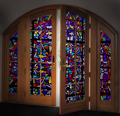 Colorful stained glass panels in a large wooden door make it a beautiful way to greet visitors. Stained glass doors provide a great first impression.