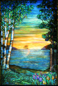 A ship sails into the sunset in a Tiffany style stained glass panel