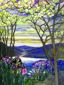 Magnolias and irises bloom in this stained glass depiction of a lake