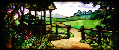 A path leads through a wooden fence beside a well into a pastoral background in this gorgeous stained glass insert, perfect for a library.