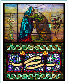 A stained glass image of the Visitation between Mary and Elizabeth makes a great stained glass memorial. Display memorials in stained glass in your church or home.