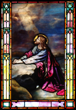 Stained glass image of Christ praying in Gethsemane
