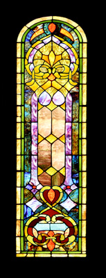 A colorful stained glass panel with a classic design