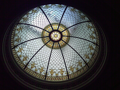 A large decorative dome in pictured with light shining through