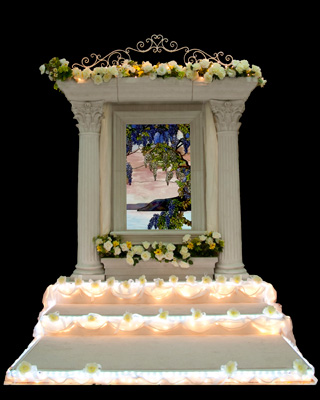A beautiful wedding backdrop featuring a stained glass panel.